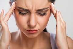 Health And Pain. Stressed Exhausted Young Woman Having Strong Te. Nsion Headache. Closeup Portrait Of Beautiful Sick Girl Suffering From Head Migraine, Feeling Stock Photo