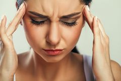 Health And Pain. Stressed Exhausted Young Woman Having Strong Te. Nsion Headache. Closeup Portrait Of Beautiful Sick Girl Suffering From Head Migraine, Feeling Stock Photos