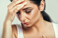Health And Pain. Stressed Exhausted Young Woman Having Strong Te. Nsion Headache. Closeup Portrait Of Beautiful Sick Girl Suffering From Head Migraine, Feeling Royalty Free Stock Images