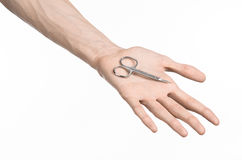 Health and personal care: Hand holding scissors for manicure isolated on white background Royalty Free Stock Photography