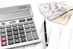 Health planning concept. Calculator, dollars and pen Stock Images