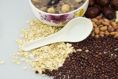 Health porridge ingredients. A pattern of white porcelain bowl and spoon, congee and porridge ingredients Stock Images