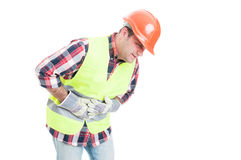 Health problem concept with builder having tummy pain Royalty Free Stock Image
