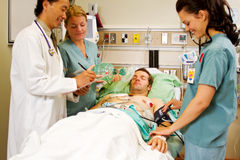 Health professionals with patient Royalty Free Stock Photos