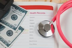 Health records in book note with fountain pen Stock Photography