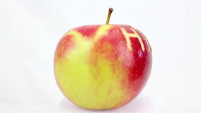 Health. Red apple engraved with Health turning on itself on a white background