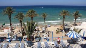 Health resort. People bathing and sunbathing on the beach stock video