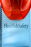 Health and safety with helmet Stock Image