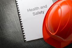 Health and safety with helmet. Health and safety register with helmet Stock Photo