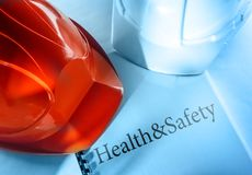 Health and safety with helmets Royalty Free Stock Image