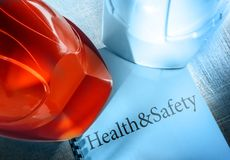 Health and safety with helmets Royalty Free Stock Photography