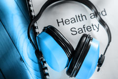 Health and safety register with earphones Royalty Free Stock Image