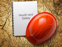 Health and safety register with helmet Royalty Free Stock Image