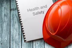 Health and safety register with helmet Stock Images