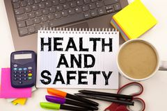 Health and Safety text in the office with surroundings such as laptop, marker, pen, stationery, coffee. Business concept for Aware. Ness Standard construction stock image