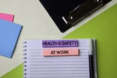 Health & Safety at Work text on top view office desk table of Business workplace and business objects stock photos