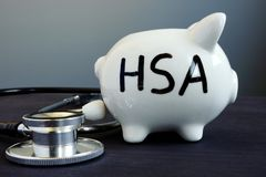 Health Savings Account HAS written on a piggy bank. Health Savings Account HAS written on the piggy bank royalty free stock images