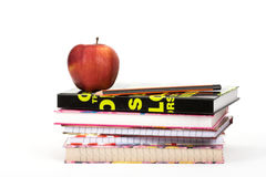 Health in school. Red apple and a pile of books stock images