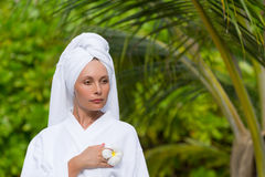 Health, spa and beauty concept - beautiful woman in towel Stock Image