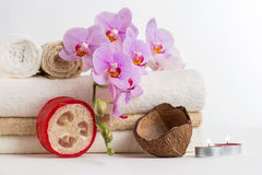 Health spa and flower orchid. Spa treatment - relax with candles. Royalty Free Stock Photo