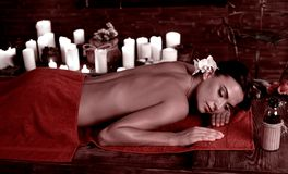 Health SPA and wellness tourism. Exotic relax massage. Health SPA and wellness tourism. Exotic massage for female body with toning sepia effect in parlor stock image