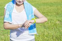 Health sport young woman run and look wear smart watch Stock Image