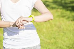 Health sport young woman run and look wear smart watch Stock Photos