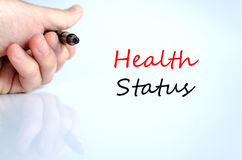 Health Status concept. Pen in the hand  over white background Healt Status concept Stock Images