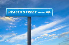 Health street next exit slogan on street sign Stock Photography