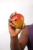 Health and Strength. This is an image of a man holding a mango. (Please let me know where the image will be used by leaving a message in the Comments Section/See stock image
