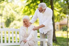 Senior woman suffering from headache outdoors. Health, stress, old age and people concept - senior women suffering from headache outdoors Royalty Free Stock Photography