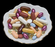 Health supplements tablets vitamins isolated black Stock Image
