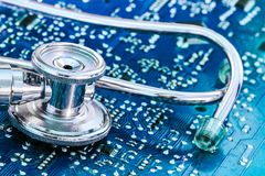Health and Technology Stethoscope on Circuit Board. Blue concept photograph stock photography