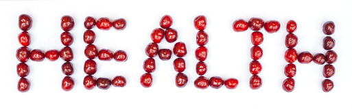 HEALTH text made of cherries. Concept. HEALTH text made of cherries. Isolated on white background. Isolated on white Royalty Free Stock Images