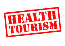 HEALTH TOURISM. Red Rubber Stamp over a white background Stock Photo