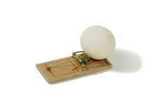 Health trap. Mouse trap used to catch small rodents, Large white eggs used in cooking Stock Image