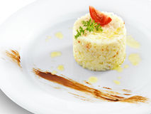Health vegetarian rice with tomato and butter. On a round plate royalty free stock photos