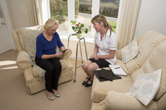 Health visitor on a home visit with elderly lady Royalty Free Stock Photography