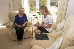 Health visitor on a home visit with elderly lady Stock Photo