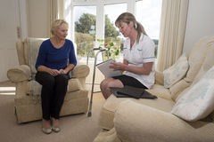 Health visitor on a home visit with elderly lady Stock Images