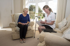 Health visitor on a home visit with elderly lady Royalty Free Stock Photo