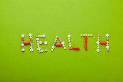 Health of vitamins. The word health made of colored vitamins Stock Photography