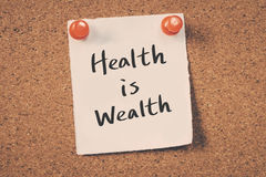 Health is Wealth. Concept word text message on bulletin board Stock Image