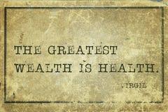 Health wealth Virgil. The greatest wealth is health - ancient Roman poet Virgil quote printed on grunge vintage cardboard stock image