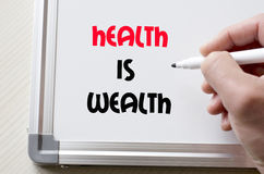 Health is wealth written on whiteboard Royalty Free Stock Photography