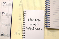 Health and wellness write on notebook. Health and wellness text concept write on notebook royalty free stock images