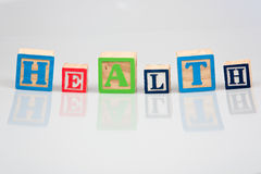 Health in wooden blocks Stock Images