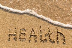 Health - word drawn on the sand beach Royalty Free Stock Photos
