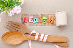 Health word and wooden spoon with Measure tape Stock Photography