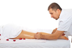 Health worker give anti cellulite massage. Health worker man giving anti cellulite massage to  a woman legs Stock Image